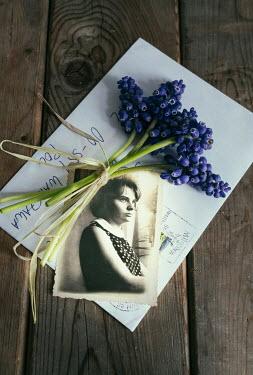 Jaroslaw Blaminsky PHOTOGRAPH LETTER AND FLOWERS ON TABLE