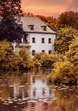 Jaroslaw Blaminsky LARGE WHITE HOUSE BY RIVER WITH TREES