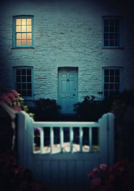 Lyn Randle LIGHT IN WINDOW OF WHITE COTTAGE AT NIGHT