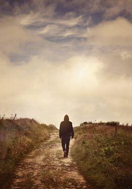 Lyn Randle MAN IN HOODIE WALKING ON COUNTRY PATH