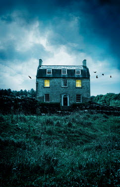 Stephen Mulcahey LIGHTS GLOWING IN WINDOWS OF COUNTRY HOUSE AT DUSK