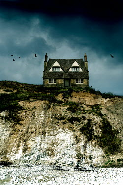 Stephen Mulcahey HISTORICAL HOUSE ON EDGE OF CLIFF BY BEACH