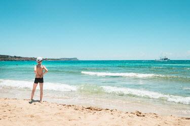 Evelina Kremsdorf LITTLE BOY IN CAP ON BEACH IN SUMMER
