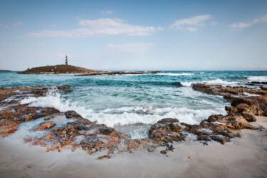 Evelina Kremsdorf DISTANT LIGHTHOUSE ON ISLAND WITH ROCKY BEACH