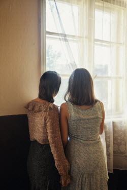 Kerstin Marinov TWO YOUNG GIRLS WATCHING AT WINDOW