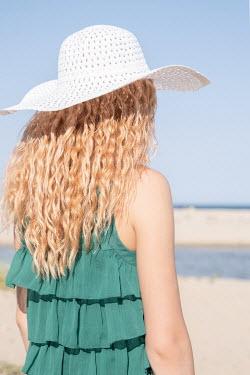 Maria Petkova BLONDE WOMAN IN HAT ON SANDY BEACH