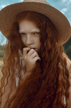 Natasha Yankelevich SERIOUS GIRL WITH RED HAIR IN HAT OUTDOORS