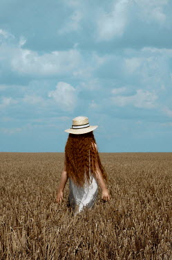 Natasha Yankelevich GIRL WITH RED HAIR AND HAT IN WHEAT FIELD