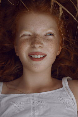 Natasha Yankelevich GIRL WITH RED HAIR AND FRECKLES LYING OUTDOORS