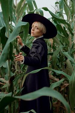 Natasha Yankelevich BLONDE WOMAN WITH HAT IN CORN FIELD