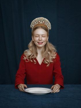 Natasha Yankelevich WOMAN WITH TIARA SITTING WITH EMPTY PLATE
