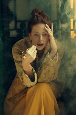 Natasha Yankelevich WOMAN SITTING SMOKING PIPE INDOORS