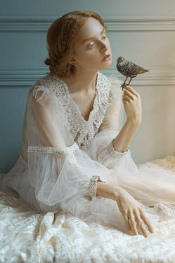 Natasha Yankelevich DREAMY WOMAN IN WHITE ON BED WITH BIRD