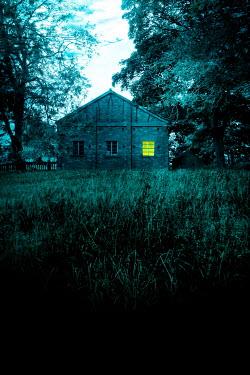 Stephen Mulcahey WAREHOUSE IN FIELD WITH LIGHT IN WINDOW