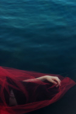 Daria Amaranth FEMALE HAND WITH RED VEIL FLOATING IN WATER