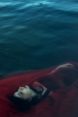 Daria Amaranth WOMAN WITH RED VEIL FLOATING IN WATER