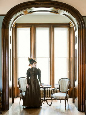 Elisabeth Ansley HISTORICAL WOMAN INDOORS STANDING BY WINDOW
