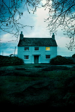 Stephen Mulcahey COTTAGE IN WINTER WITH LIGHT IN BEDROOM WINDOW