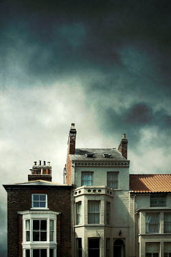 Miguel Sobreira HISTORICAL TERRACED HOUSES WITH STORMY SKY