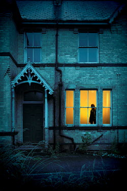 Miguel Sobreira WOMAN IN WINDOW OF HOUSE AT DUSK