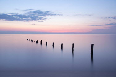 Michael Nelson POSTS IN CALM SEA AT SUNSET