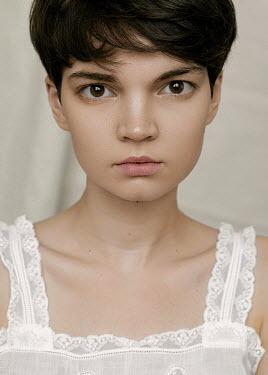 Natasha Yankelevich SERIOUS WOMAN IN WHITE LACY DRESS