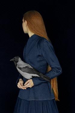 Natasha Yankelevich WOMAN WITH LONG RED HAIR HOLDING BIRD