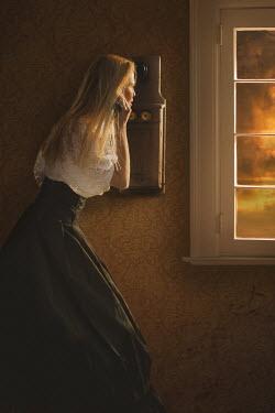 Robin Macmillan BLONDE WOMAN ON TELEPHONE WATCHING AT WINDOW