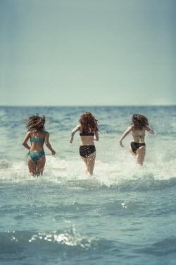 Robin Macmillan THREE GIRLS IN BIKINIS RUNNING IN WATER