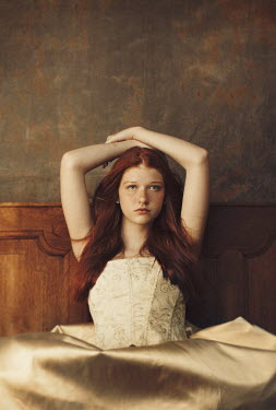 Robin Macmillan SAD GIRL WITH RED HAIR SITTING IN BED