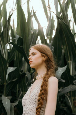 Dorota Gorecka GIRL WITH RED HAIR STANDING IN CORN FIELD
