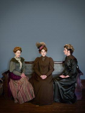 Elisabeth Ansley THREE HISTORICAL WOMEN SITTING ON SOFA