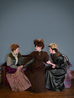 Elisabeth Ansley THREE HAPPY HISTORICAL WOMEN SITTING ON SOFA