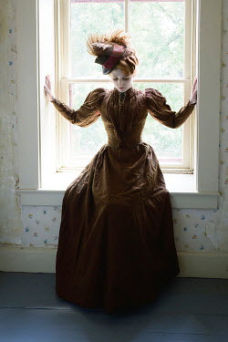 Elisabeth Ansley HISTORICAL WOMAN WITH HAT SITTING IN WINDOW