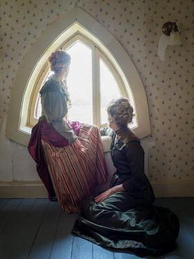 Elisabeth Ansley TWO HISTORICAL WOMEN STIING BY WINDOW