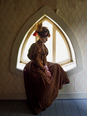 Elisabeth Ansley SERIOUS HISTORICAL WOMAN SITTING IN WINDOW