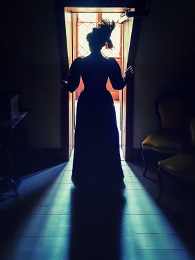 Elisabeth Ansley SILHOUETTED HISTORICAL WOMAN STANDING INDOORS