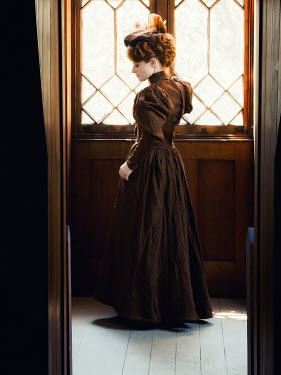 Elisabeth Ansley HISTORICAL WOMAN WITH RED HAIR STANDING BY WINDOW