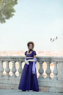 Ildiko Neer Regency woman standing on terrace