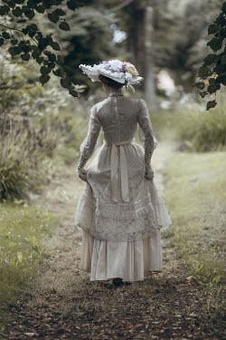 Magdalena Russocka historical woman wearing hat walking in garden