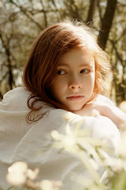 Natasha Yankelevich YOUNG GIRL WITH RED HAIR SITTING OUTDOORS