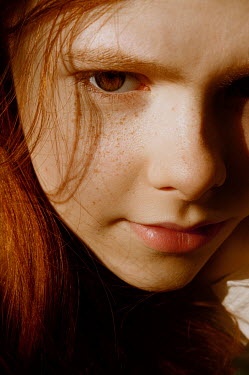Natasha Yankelevich YOUNG GIRL WITH RED HAIR AND FRECKLES IN SUNLIGHT