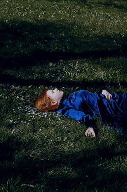 Natasha Yankelevich YOUNG GIRL WITH RED HAIR LYING ON GRASS