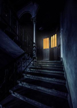 Jaroslaw Blaminsky STAIRCASE WITH LIGHTS SHINING IN DOORWAY ON LANDING