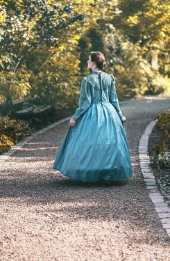 Jaroslaw Blaminsky HISTORICAL WOMAN WALKING ON PATH IN PARK