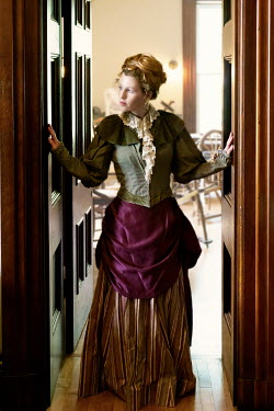Elisabeth Ansley SERIOUS HISTORICAL WOMAN STANDING IN DOORWAY
