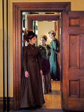 Elisabeth Ansley THREE HISTORICAL WOMEN STANDING INSIDE HOUSE