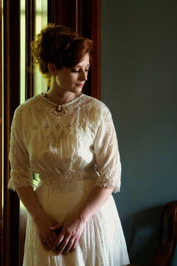 Elisabeth Ansley SERIOUS HISTORICAL WOMAN WITH RED HAIR INDOORS
