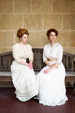 Elisabeth Ansley TWO HISTORICAL WOMEN IN WHITE SITTING ON BENCH