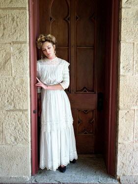 Elisabeth Ansley SAD BLONDE HISTORICAL WOMAN STANDING BY DOORWAY